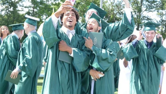 Students from J.F. Kennedy High School in the Iselin section of Woodbridge Township celebrate graduation last year.