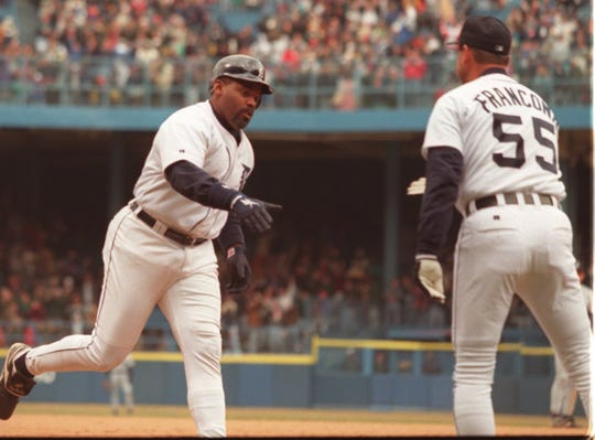 Tigers first baseman Cecil Fielder shakes hands with third base coach Terry Francona after a grand slam against the Mariners on April 9, 1996, at Tiger Stadium.
