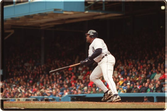 Tigers first baseman Cecil Fielder hits a grand slam against the Mariners on April 9, 1996, at Tiger Stadium.
