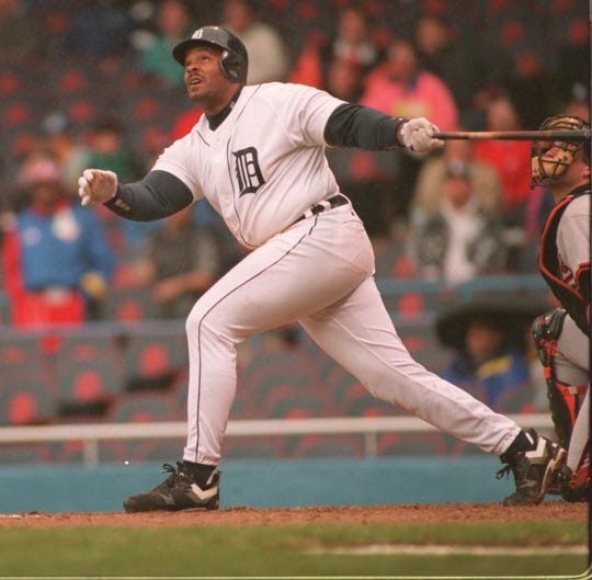 Tigers first baseman Cecil Fielder watches his home run fly to left in the sixth inning against the Orioles on April 13, 1994, at Tiger Stadium.