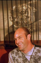 Former Detroit Tiger Kirk Gibson smiles as he speaks at a news conference in Detroit on Aug. 16, 1995. Gibson, 38, retired after spending 12 years of his 17-year career with the Tigers.