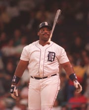 Tigers first baseman Cecil Fielder flips his bat after striking out against the Red Sox on June 7, 1994, at Tiger Stadium.