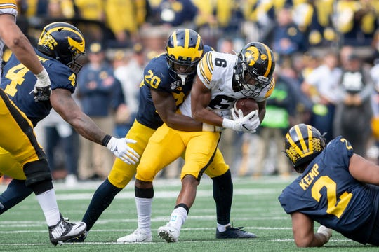 Safety Brad Hawkins (20) finished the season with 53 tackles and was named Michigan's most improved defensive player.