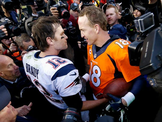 In this Jan. 24, 2016, photo, New England Patriots quarterback Tom Brady, left, and Denver Broncos quarterback Peyton Manning speak to one another following the AFC championship game in Denver.