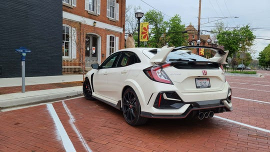 Take out. The 2020 Honda Civic Type R is small enough to maneuver in downtown Ann Arbor for a pickup sandwich (see bag on roof) at Zingerman's. Yet roomy enough inside to eat on the fly.