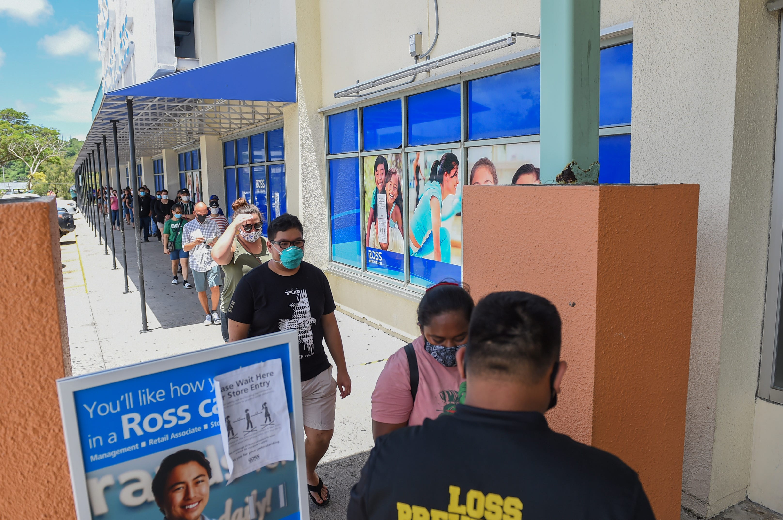 A long line of customers forms during the reopening of Ross Dress for Less at Guam Premier Outlets in Tamuning, May 24, 2020.