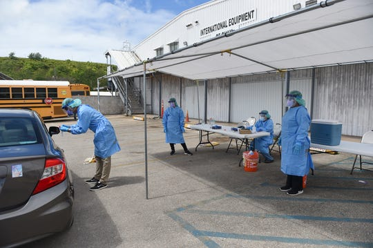 Expanded testing for COVID-19 is conducted by Department of Public Health and Social Services and the Guam Department of Education staff in Harmon Industrial Park in this May 24 file photo. Those who want to get tested for COVID-19 can do so in the next few weeks via planned drive-through testing.