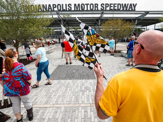 Brent Gulla stands at the main gates waving flags outside of the Indianapolis Motor Speedway, Sunday, May 24, 2020. The Indianapolis 500 has been delayed until August due to the COVID-19 pandemic.