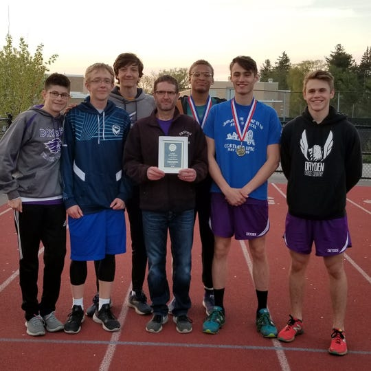 Dryden coach Lee Stuttle, shown here with team members at last year's IAC track & field championships, will retire after 30 years coaching his alma mater.