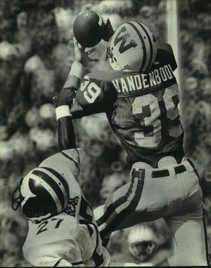 Matt Vanden Boom of the University of Wisconsin intercepts a pass in front of Vincent Bean of Michigan in the third quarter of the 1981 win.