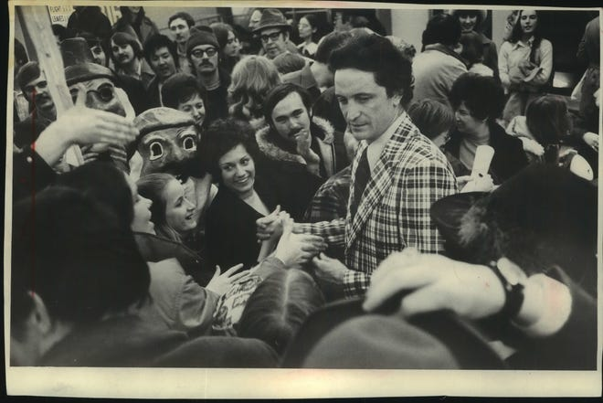 Well-wishers and jubilant fans turned out at Mitchell Field to greet Al McGuire and his Marquette basketball team on its return from Tuscaloosa, Alabama, where they won the NCAA Mideast Regional crown.