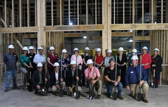 Food Bank of North Central Arkansas officials, volunteers and supporters held a ceremonial groundbreaking Friday afternoon for the organization's new offices currently under construction in the former Fred's Building in Georgetown Square in Mountain Home.