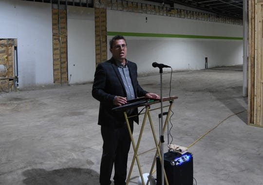 Food Bank of North Central Arkansas CEO Jeff Quick addresses a crowd of about 40 people Friday at the ceremonial groundbreaking for the organization's new offices in Mountain Home.