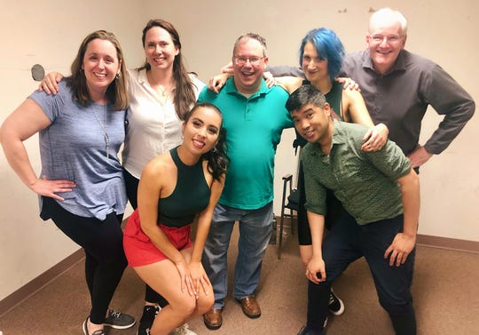 Brian Shea, in the middle, and Heather Carlson, in the front left, became friends through the Baltimore Improv Group. They can no longer preform at the theater because of COVID-19 restrictions, but are finding new ways to stay creative online.