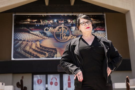 Julie Dougherty, venue manager at Celebrity Theatre in Phoenix, poses for a picture outside the theater on May 13, 2020.