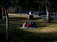 Mary Nadarski and Stefani Gurley relax before getting food and drinks at Dr. AJ Chandler Park in Chandler on May 23, 2020.