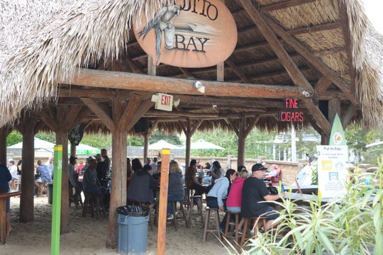 Mojito Bay, a popular tiki bar at Put-in-Bay, is implementing social distancing rules and sanitizing the facility every two hours.