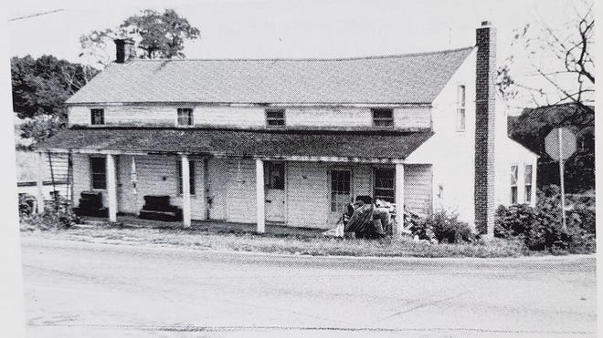 """The caption for the tavern building could read """"Crosby Tavern building around 1980."""""""