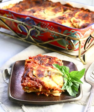 Garden lasagna has three types of melted cheeses, pasta, mushrooms, carrots, tomatoes and two kinds of roasted squash.