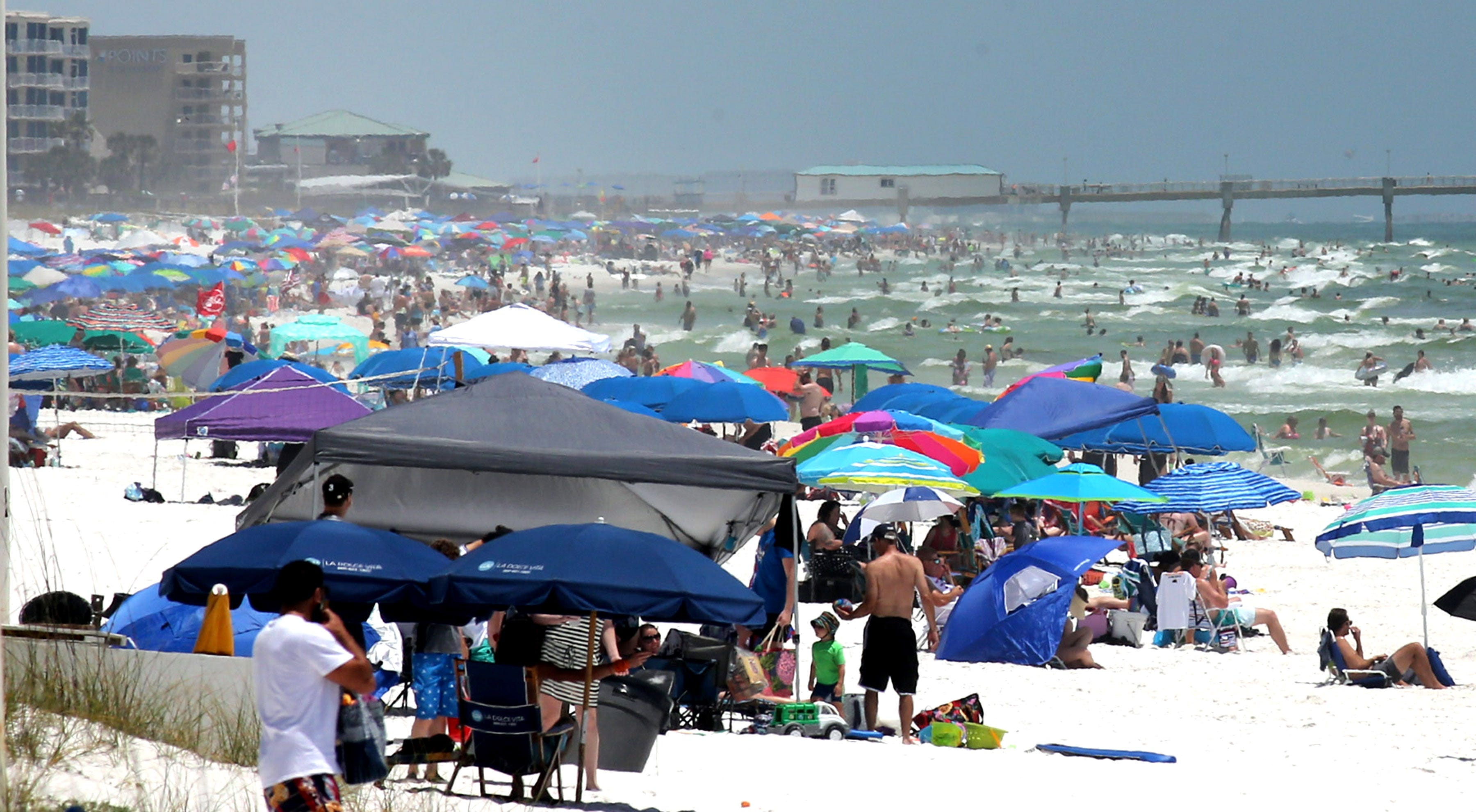 People pack the beaches on Okaloosa Island, Florida, as the long Memorial Day weekend begins.