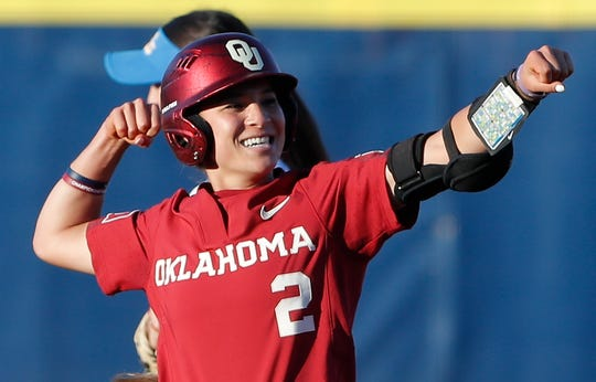Oklahoma's Sydney Romero gestures after making it to second base against UCLA in the first inning of Game 2 of the best-of-three championship series in the Women's College World Series.