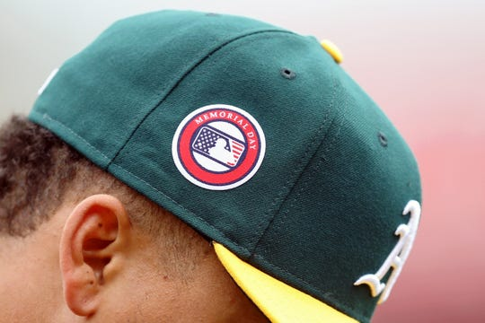 Oakland A's pitcher Frankie Montas wears a hat commemorating Memorial Day before last year's game against the Los Angeles Angels.
