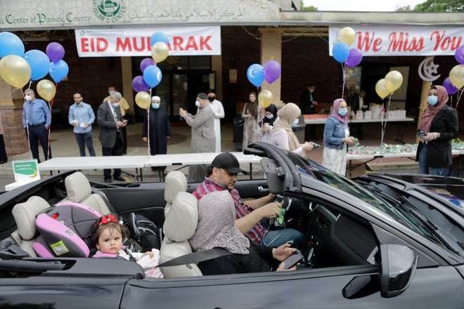The Ali family traveled from Manhattan to the Islamic Center of Passaic County to celebrate the end of the holy month of Ramadan. To  practice social distancing the Paterson mosque decided to have a car parade instead of a normal gathering that would typically draw thousands of people to celebrate the end of the holy month of Ramadan on Sunday, May 24, 2020 in Paterson, N.J.