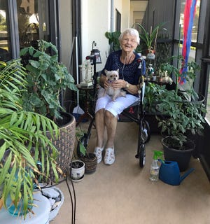 Eunice Zelle passes the time during the pandemic caring for her tomato and pepper plants at Courtenay Springs Village on Merritt Island. Zelle and her dog Annie have been residents of the Merritt Island assisted living facility for four years.