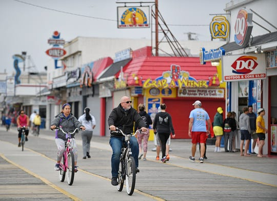A crowd of bike riders stroll down the Wildwood boardwalk on Memorial Day.
