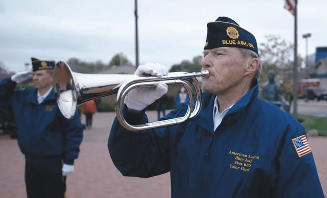 "The bugler from Blue Ash American Legion Northeast Post 630 participated in a ceremony honoring Blue Ash's veterans including Donald ""Scott"" Morrison, killed in Afghanistan in 2010 ."