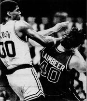 Robert Parish strikes Bill Laimbeer with a forearm to the face in Game 5.
