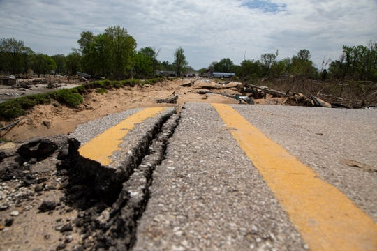 Saginaw Rd. at the bridge that crosses the Tittabawassee River in Sanford is severely damaged as volunteers help rebuild their towns on Memorial Day, May 25, 2020. Floodwaters have devastated communities like Midland and Sanford following the failure of two dams that flooded homes along the Tittabawassee River.