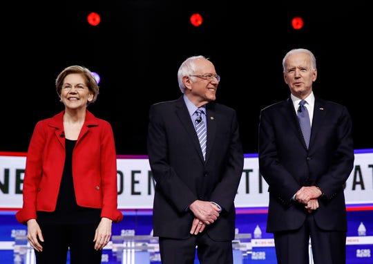 Democratic presidential candidates Sen. Elizabeth Warren, D-Mass., Sen. Bernie Sanders, I-Vt., and former Vice President Joe Biden participate in a Democratic presidential primary debate Feb. 25 in Charleston, S.C.