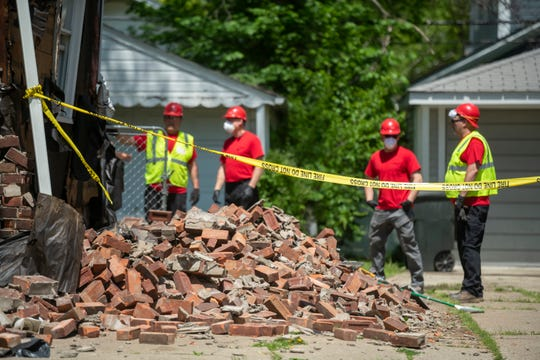 Workers inspect 1365 Chapin, in Birmingham, May 25, 2020.  The house was the scene of an explosion the morning of Memorial Day.