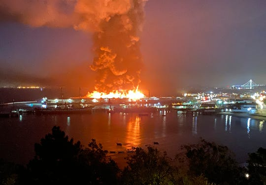 This photo courtesy of Dan Whaley, @dwhly, shows a warehouse fire burning at San Francisco's Fisherman's Wharf in San Francisco early Saturday. The fire tore through the warehouse, sending thick smoke over the waterfront and causing its walls to collapse.  (Dan Whaley, @dwhly via AP)