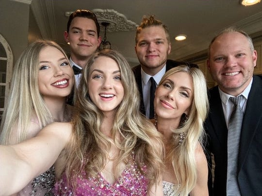 The Hutchinson family at Easter: Front row, daughters Aria, left, and Mia, wife Melissa and Chris; back row, Mia's boyfriend, Tim Jones, and Aidan.