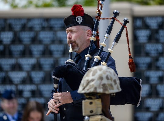 Jesse Callender plays a bagpipe salute at Monday's Memorial Day ceremony at the Montana Veterans Memorial in Great Falls.