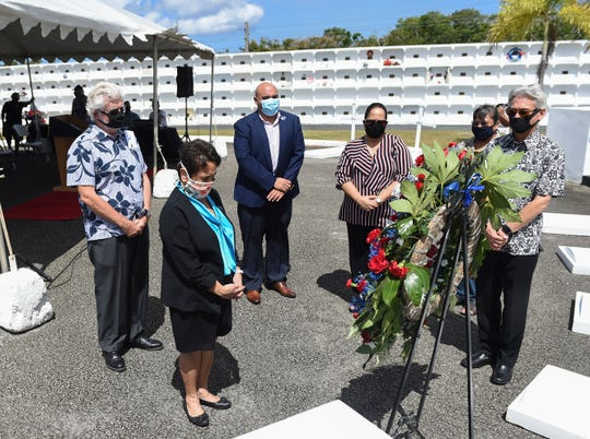Dignitaries pay their respects for the Tomb of the Unknowns during a Memorial Day commemoration ceremony at Guam Veterans Cemetery in Piti, May 25, 2020.