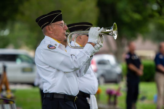 Adam Mouton playing bugle during Memorial Day Service at Fountain Memorial Cemetery. Monday, May 25, 2020.
