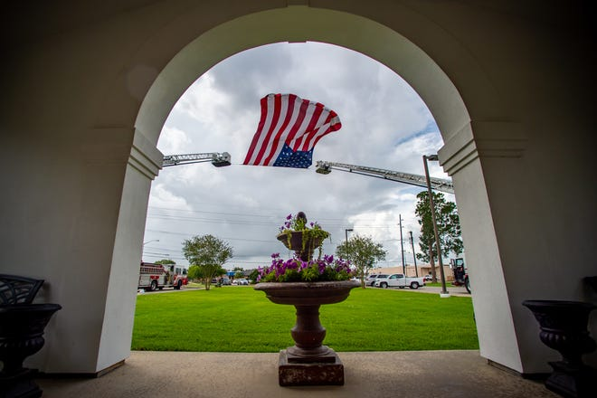 The Lafayette Fire Dept. flies the American flag during Memorial Day Service at Fountain Memorial Cemetery. Monday, May 25, 2020.