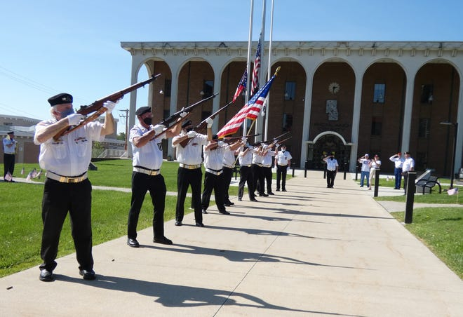 Members of the Joint Veteran Burial Squad fire a rifle volley during a short Memorial Day service at 10 a.m. Monday in front of the Richland County Courthouse.
