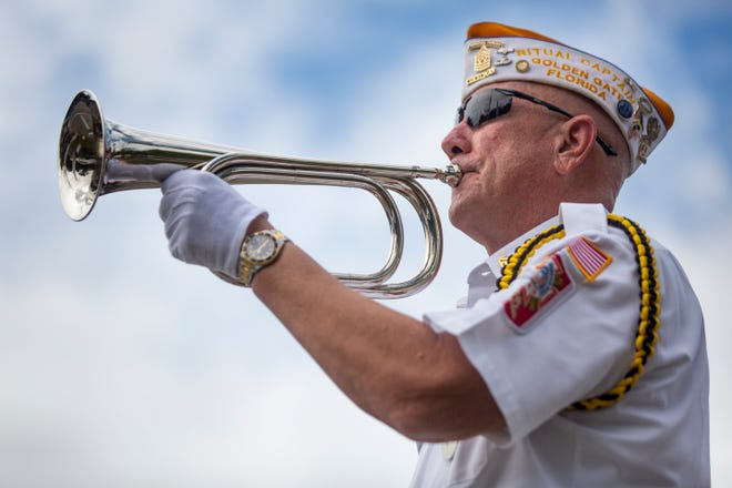 Command Sgt. Maj. James Burch plays taps during a Memorial Day service at VFW Post 7721 near Golden Gate on Monday, May 25, 2020.