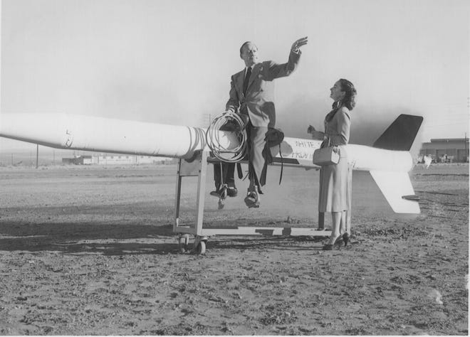 Legendary comedian Jack Benny poses on a WAC Corporal rocket during his Christmas day visit to White Sands in 1951. Accompanying him is actress and singer Ann Blyth. The two performed in the new White Sands theater to a standing-room-only crowd of personnel.