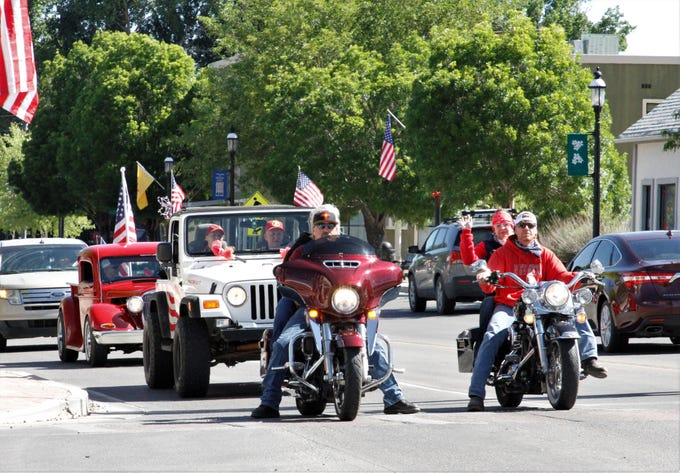 Participants in the Tri-City Memorial Cruise stop at a traffic light, Monday, May 25, 2020, in Aztec.