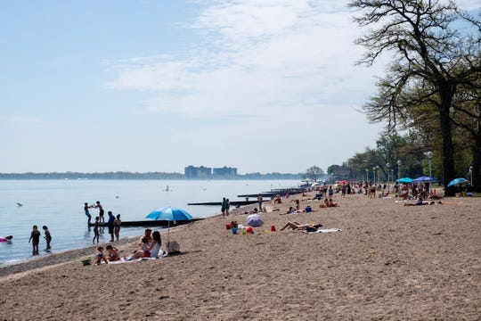The coronavirus pandemic doesn't deter crowds from forming at Lakeside Beach on Memorial Day, Monday, May 25, 2020, in Port Huron.