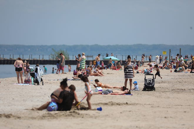 Ontario Beach was busy with groups of people enjoying the weather and keeping a distance from other groups of people on Memorial Day Monday, May 25, 2020.