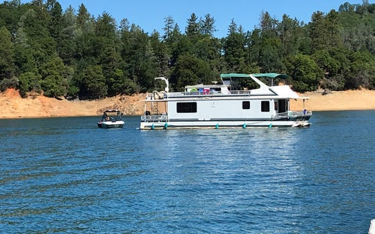 A houseboat makes its way along Lake Shasta on Memorial Day, May 25, 2020.