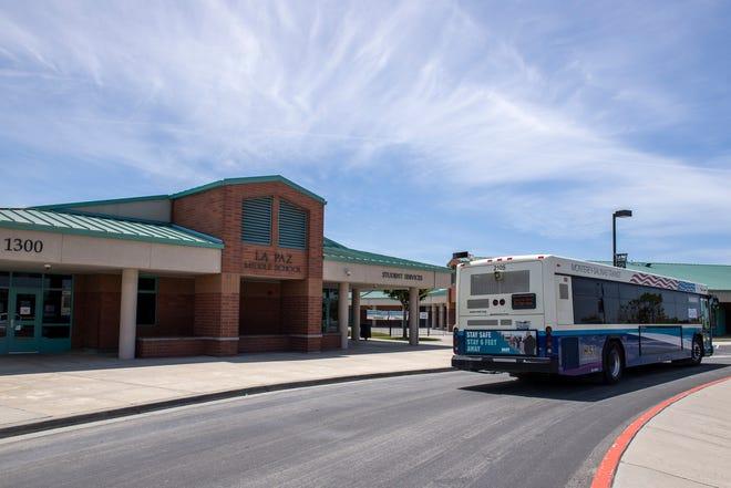 A Monterey-Salinas Transit bus drives through La Paz Middle school in Salinas on Saturday, May 16, 2020.