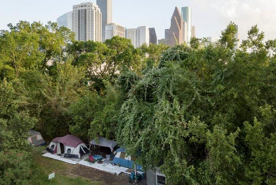 A large homeless camp near downtown Houston in 2019. Mayor Sylvester Turner said homeless shelters have become a hot spot for coronavirus. Health officials advise against moving homeless encampments during the pandemic, though they suggest homeless people have 144 square feet of space per person.