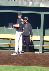 Austin Henry (left) talks with Wichita State pitching coach Mike Pelfrey during Henry's prospect camp workout in January.
